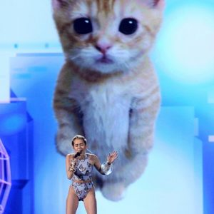 Miley Cyrus Performing With a Giant Pussy Cat