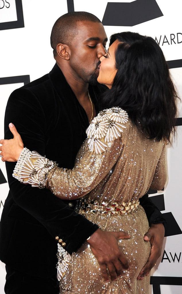 Kanye grabbing Kim's flat butt.