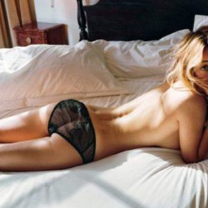 Brie Larson topless laying down in bed with black see-through underwear on
