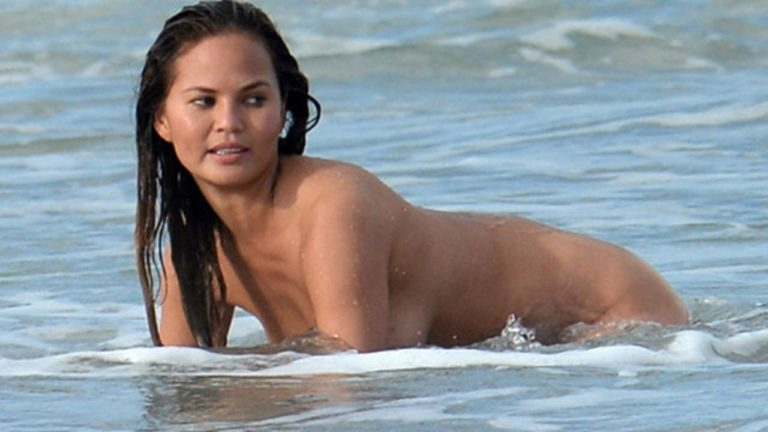 Chrissy Teigen nude on the beach (1)