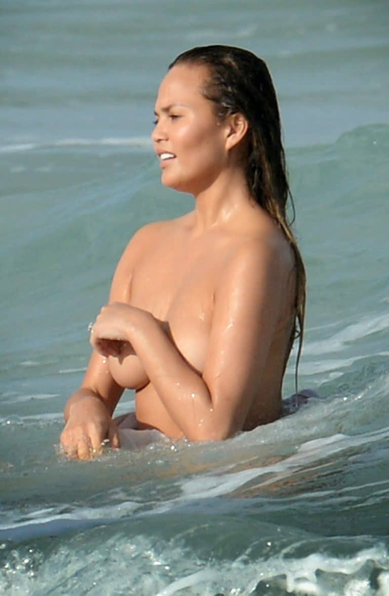 Chrissy Teigen nude on the beach (4)