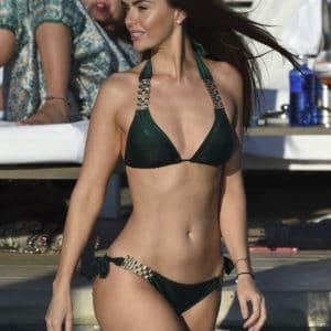 Metcalfe in green bikini while in Ibizia