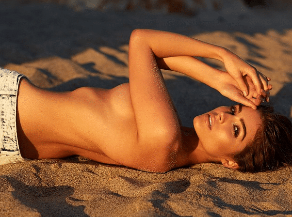 Olivia Culpo topless on beach