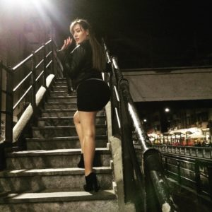 Paola Saulino in black dress upskirt