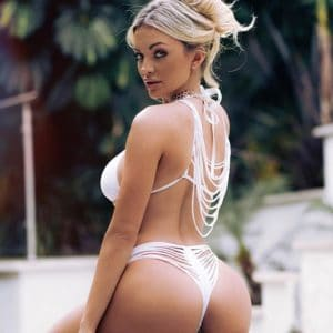 Louisiana girl Lindsey Pelas in a sexy white bikini and thong looking back at the camera with ass cheeks exposed