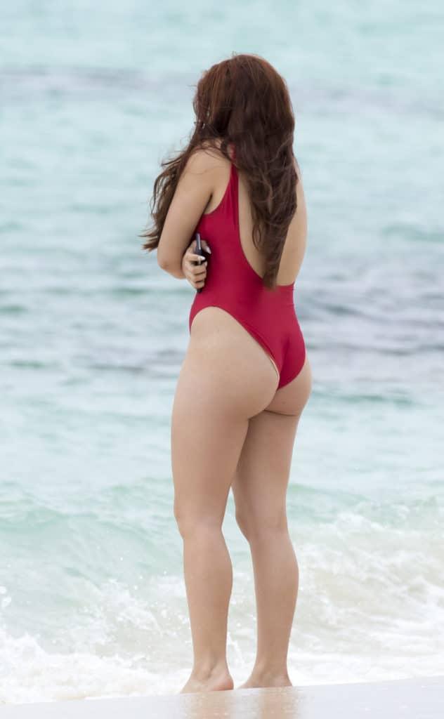 Ariel Winter in red bay watch suit