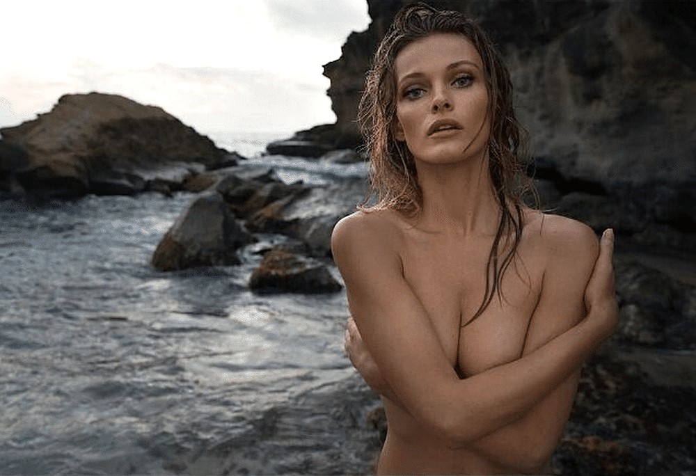 Topless Edita Vilkeviciute at the beach modeling with wet hair
