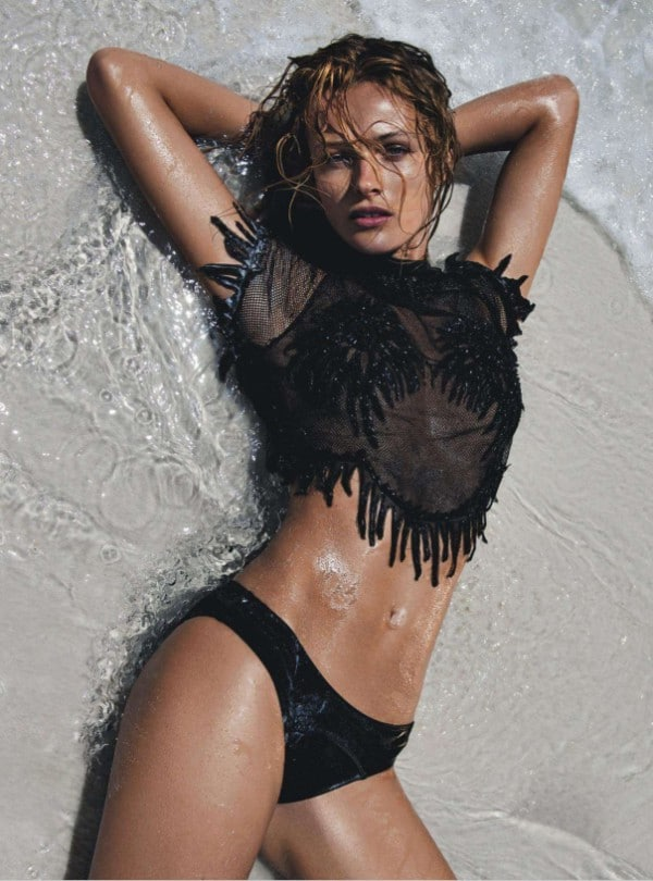 Seductive Edita Vilkeviciute in mesh black top on the beach