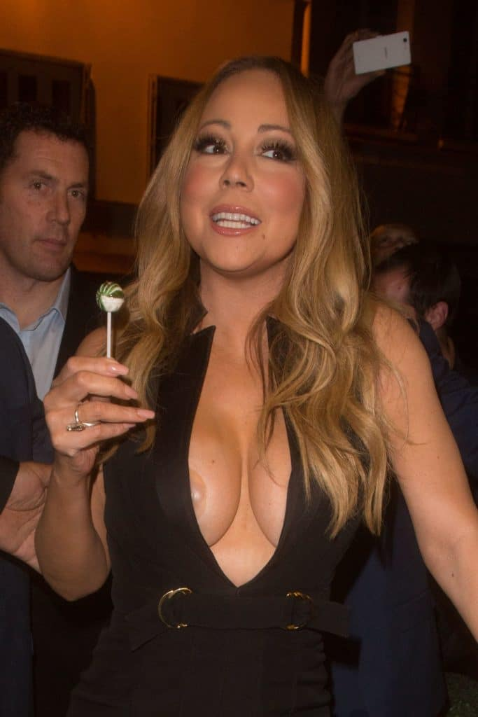 mariah carey naked nipple popping out of her dress