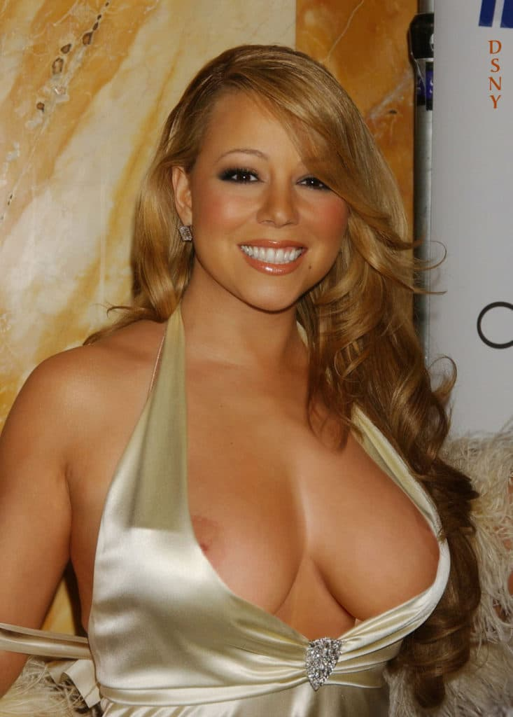 diva mariah carey suffers a nip slip in gold dress at awards show