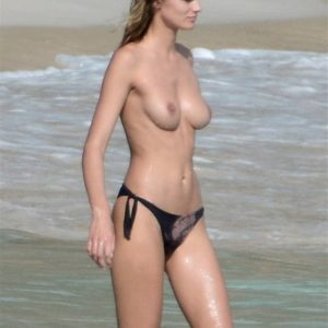 Super Model Edita Vilkeviciute topless on the beach