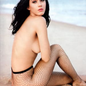 Chesty Katy Perry topless in fishnets at the beach