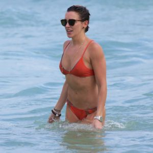 The blonde bombshell Katie Cassidy wearing sunglasses in the ocean