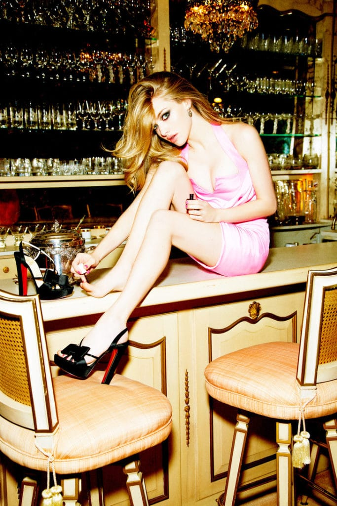 amanda seyfried in pink dress on counter