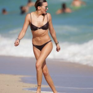 The babe Katie Cassidy showing her body off at the beach