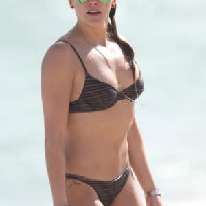 The seductive Katie Cassidy showing her boobs off at the beach