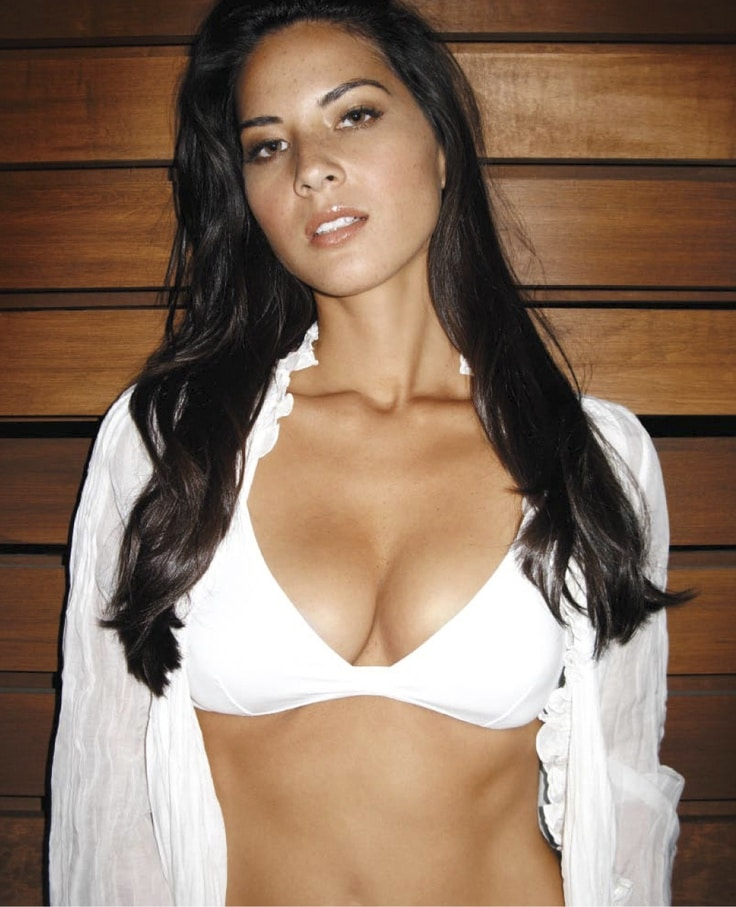 Olivia Munn white top cleavage