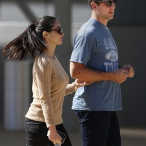 gorgeous olivia munn and her nfl football player aaron rodgers walking together