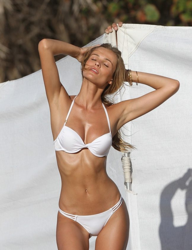 model edita vilkeviciute in a sexy bikini at the beach showing her amazing body