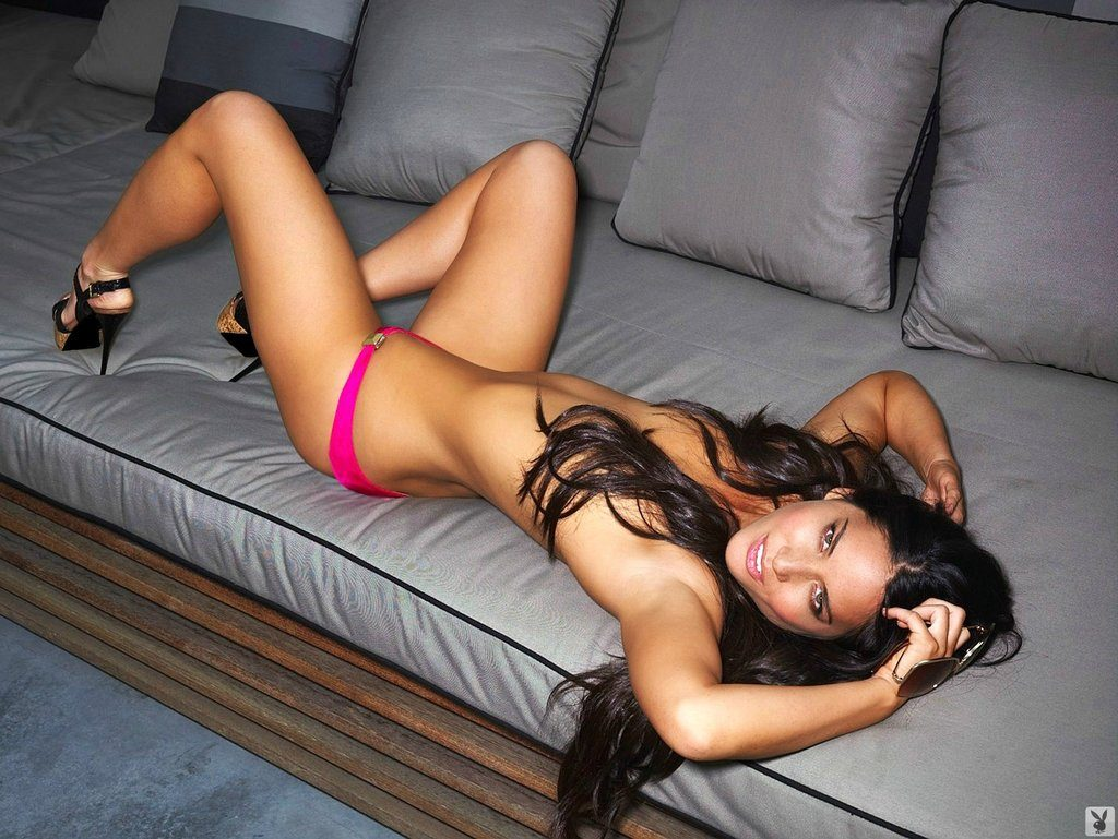 Olivia Munn poses topless for playboy laying on couch with heels on