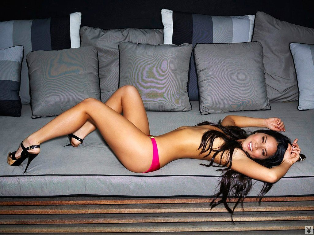 playboy magazine pic of Olivia Munn in pink panties and heels laying on couch