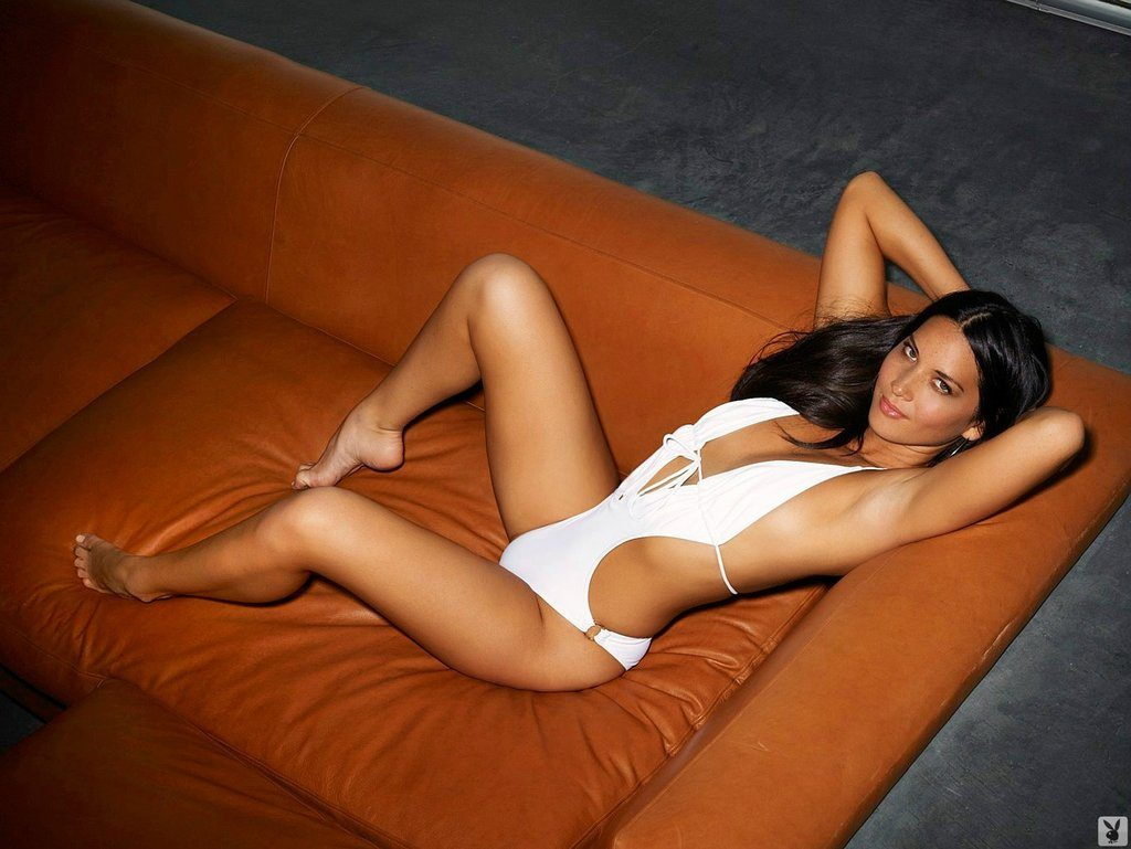 sexy olivia munn poses for playboy magazine in hot one piece laying on orange couch