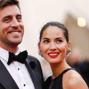 the beautiful olivia munn and aaron rodgers in suit and tie