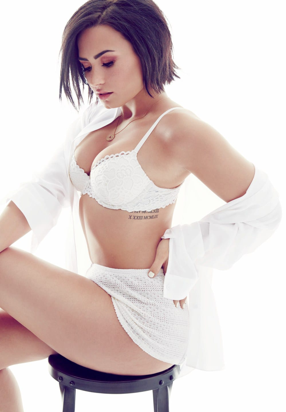 Demi Lovato showing off her hot curves in white bra and booty shorts