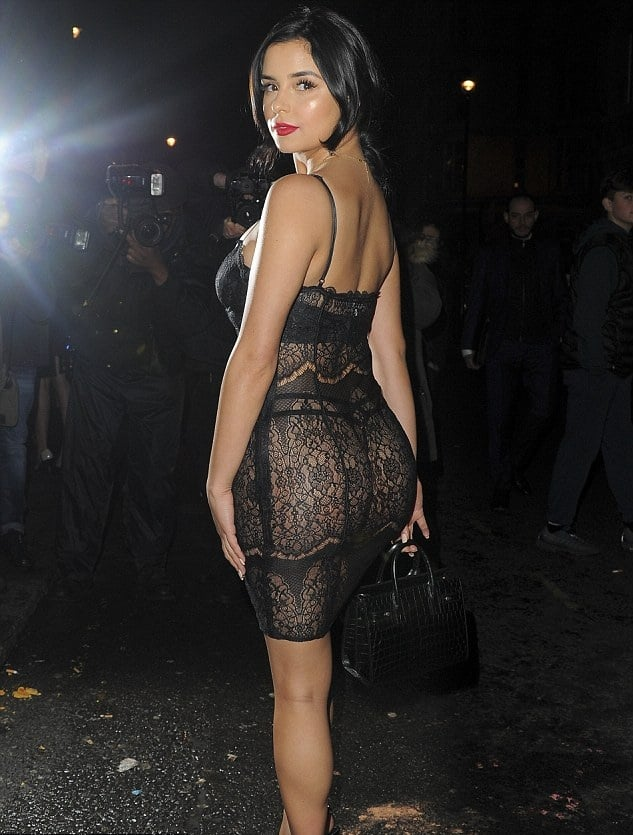 Demi Rose Mawby wearing a lacey see through black dress