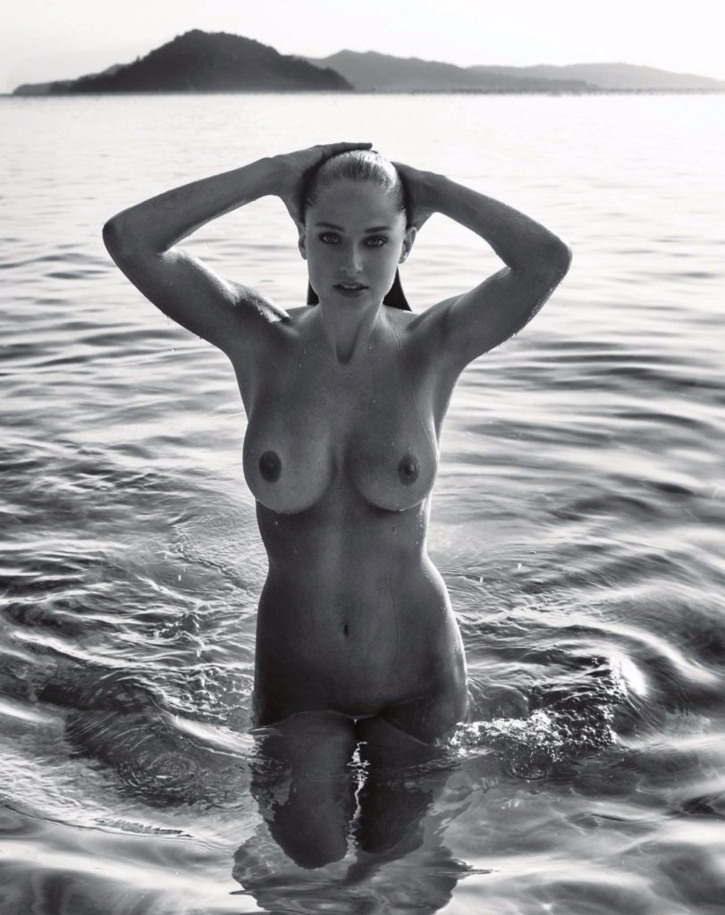 Genevieve Morton for Treats Magazine showing her big breasts in the water