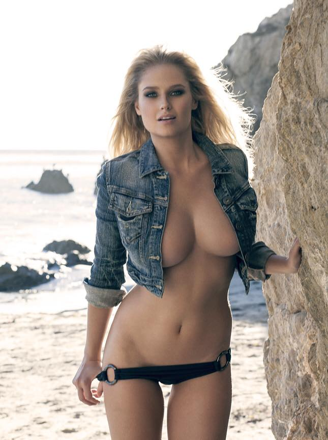 Genevieve Morton with jean jacket showcasing her big breasts