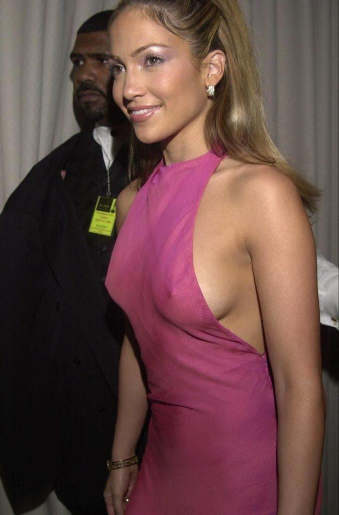 Jennifer Lopez wearing tight pink dress showing her hard nipples