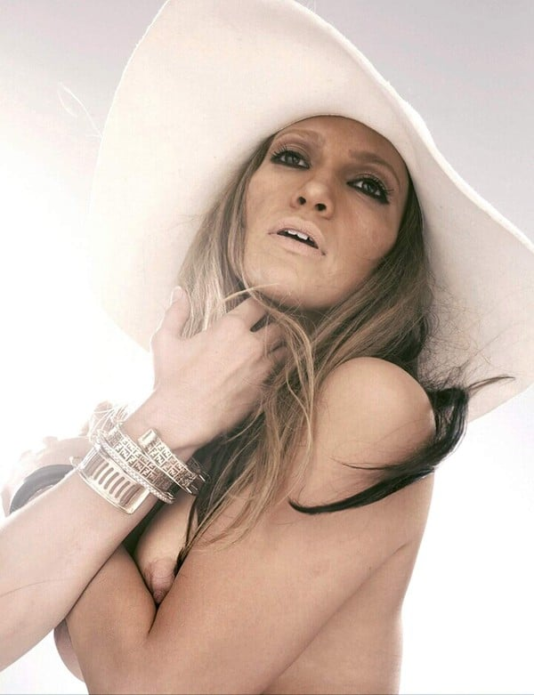 Jennifer Lopez with a white hat on baring some nipple