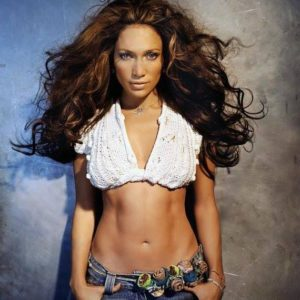 Jennifer Lopez with big hair and a white crop top shirt
