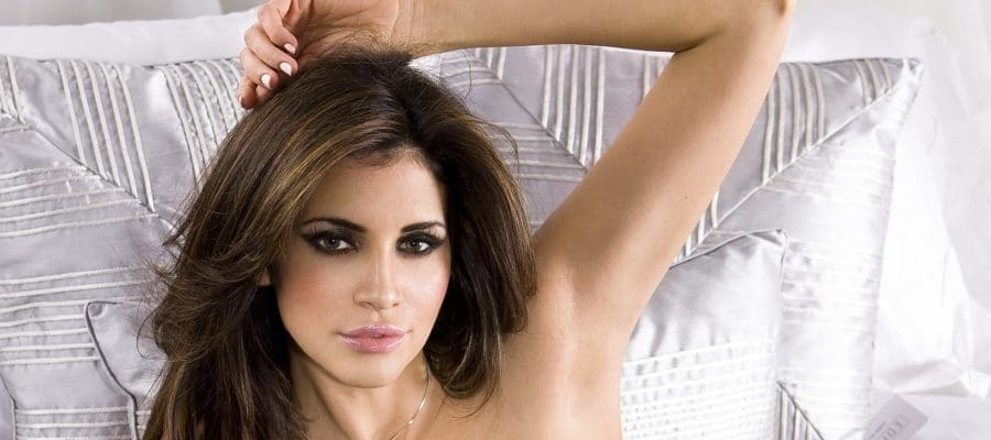 Hope Dworaczyk Smith posing in bed